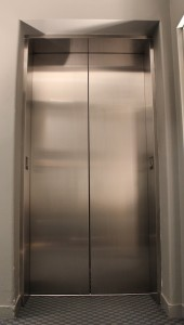 Elevator stainless steel scratch vandalism fix Vancouver
